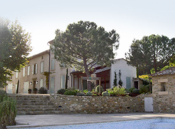 Provence farmhouse and renovated walls with new trees and plants