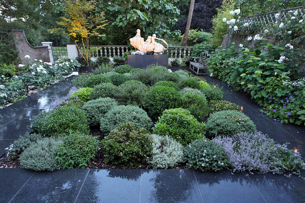 Ladbroke Square garden silver foliage and striking slab pathways