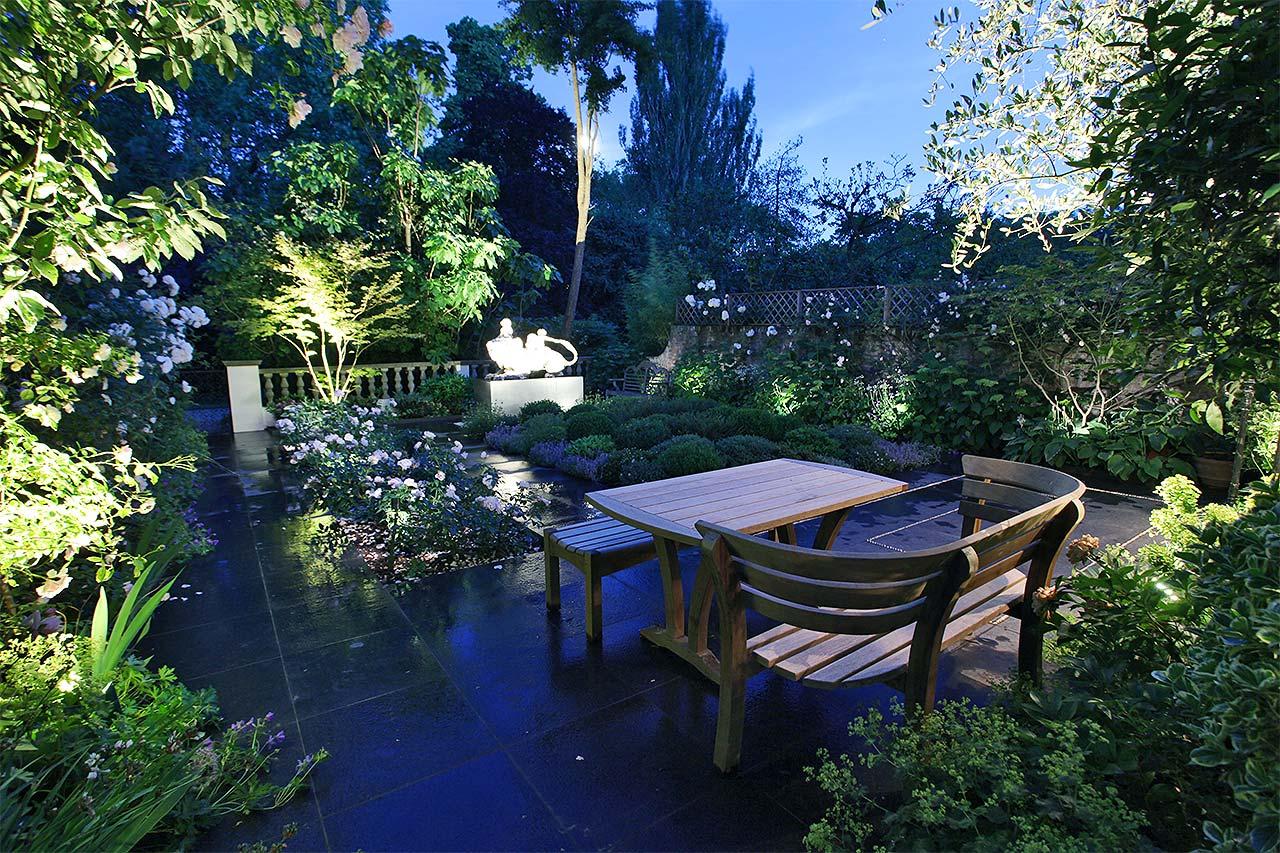 Ladbroke Square garden lit at dusk